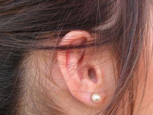 woman's ear with earring - listening