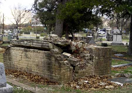 Badly damaged brick crypt or above-ground grave, Austin, TX.